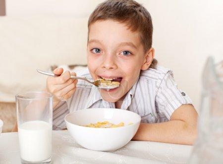 Child eat breakfast