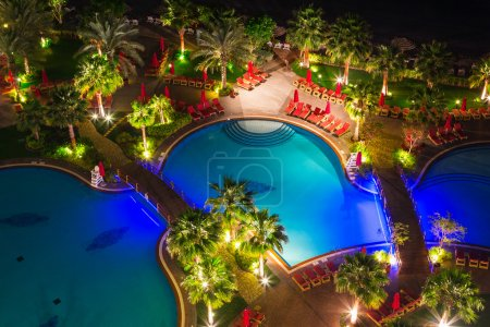 Tropical pool area at night