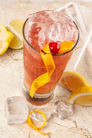Refreshing red drink with grapefruit, lemon and ice