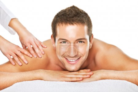 Closeup of a man having a back massage