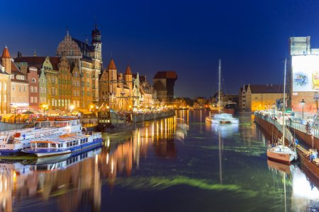 Old town of Gdansk at night with reflection in Motlawa river