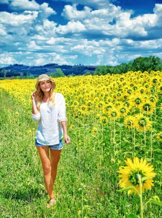 Walking on sunflowers field