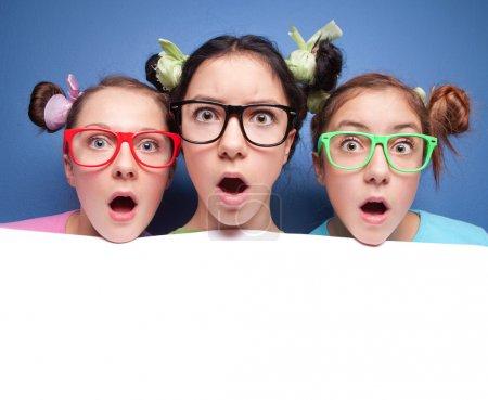 Three amazed teens with blank