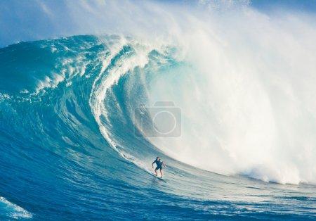 MAUI, HI - MARCH 13: Professional surfer Billy Kemper rides a gi